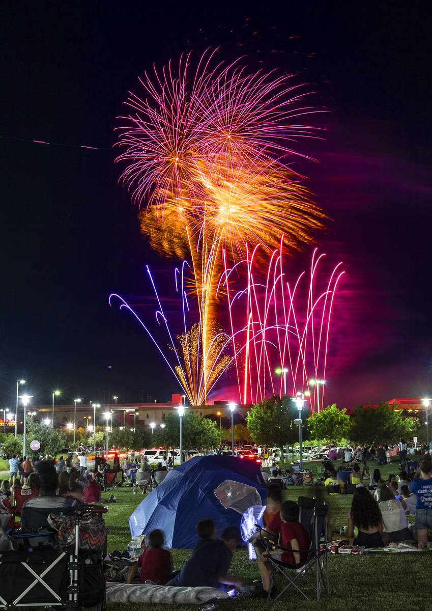 People watch the Red Rock Casino fireworks show from Downtown Summerlin on Saturday, July 4, 2 ...
