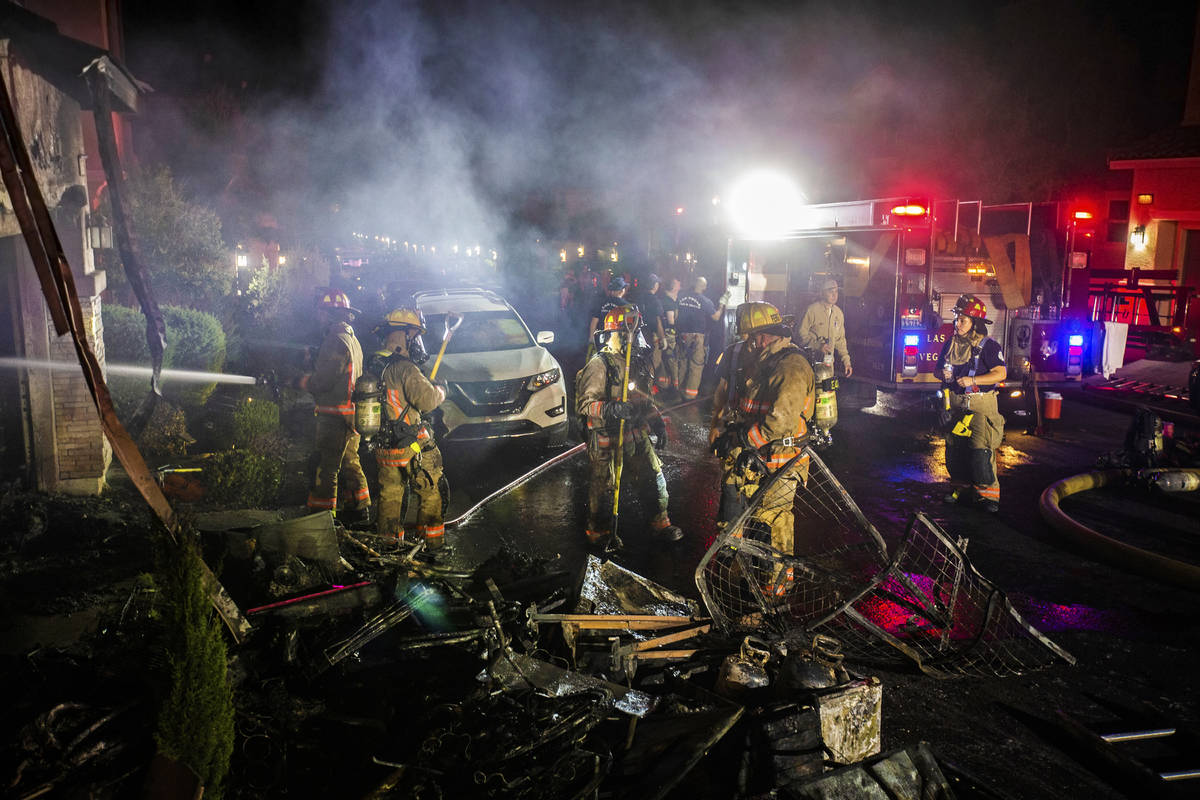 Fire fighters respond to a structure fire suspected to be caused by fireworks at 10758 Red Badg ...