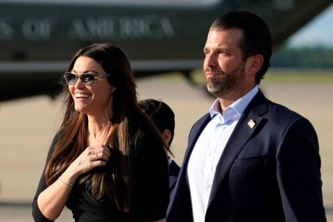 Donald Trump Jr., right, walks with his girlfriend, Kimberly Guilfoyle, after arriving at Andre ...