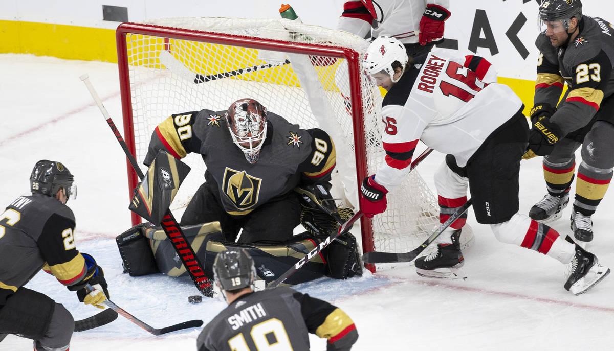 Vegas Golden Knights goaltender Robin Lehner (90) makes a save against New Jersey Devils center ...
