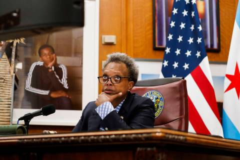 Mayor Lori Lightfoot conducts a virtual City Council meeting from her office at City Hall on We ...