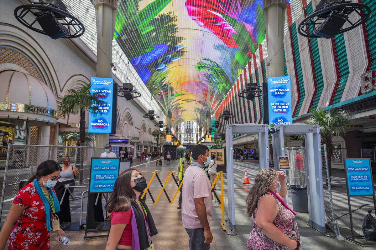 Signs state that masks are required to enter the Fremont Street Experience in downtown Las Vega ...