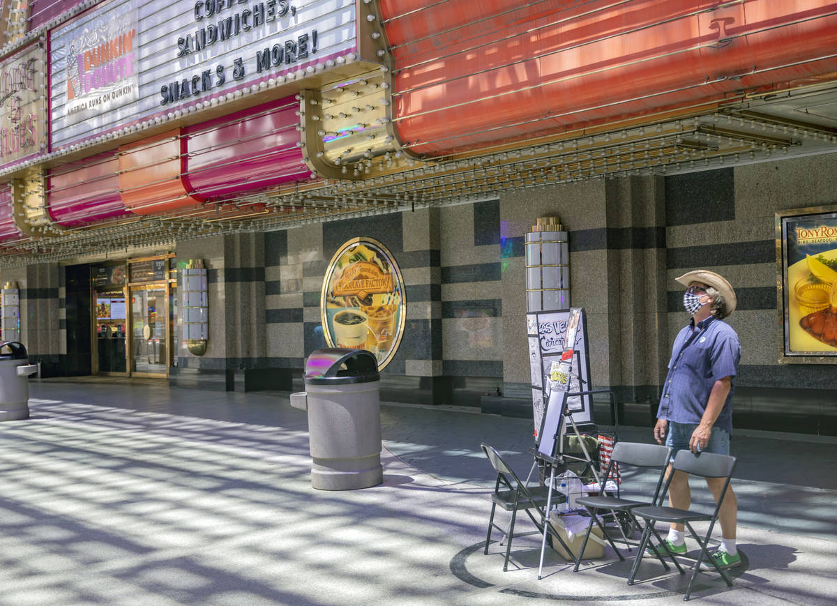 Mike Warden of Las Vegas Caricatures waits by his outdoor drawing space in the Fremont Street E ...