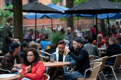 Members of the public are seen at a bar on Canal Street in Manchester's gay village, England, S ...