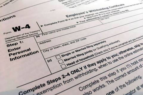 In a Feb. 5, 2020, file photo, a W-4 form is viewed in New York. As the coronavirus pandemic to ...