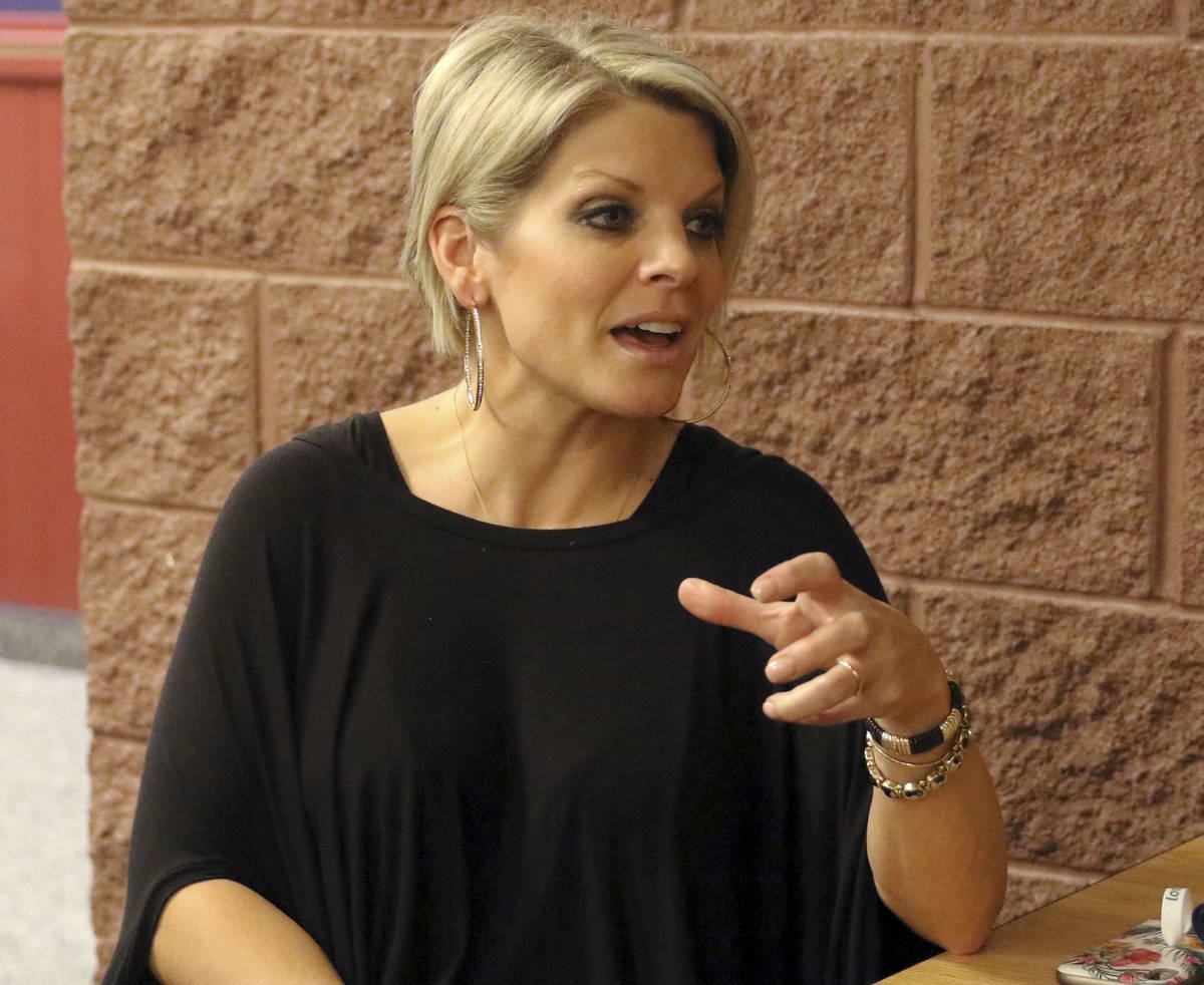 American Preparatory Academy director Rachelle Hulet responds to a question about the hiring of ...