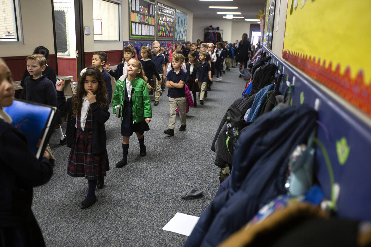 Students at American Preparatory Academy head to their reading groups on Thursday, Feb. 13, 202 ...