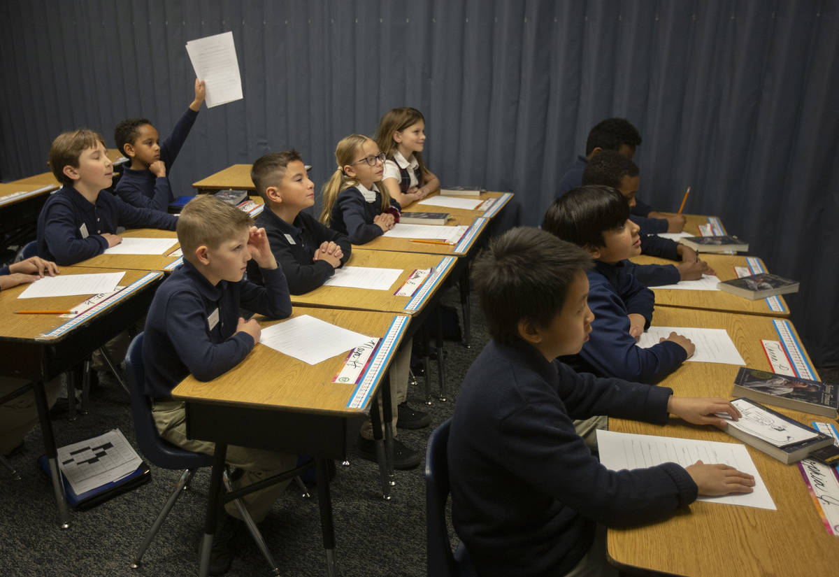 Nicole Doney's first grade class listens before they begin reading at American Preparatory Acad ...