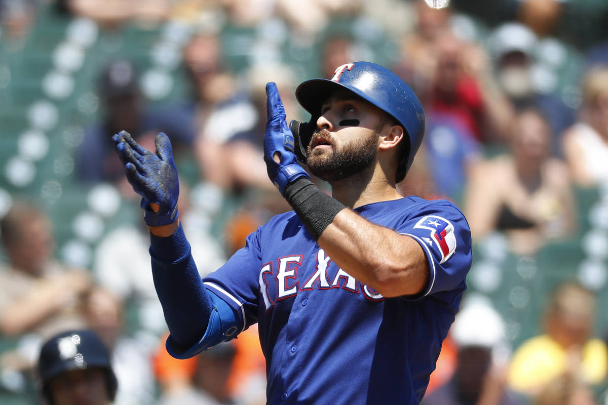 Texas Rangers' Joey Gallo celebrates his solo home run in the fourth inning of a baseball game ...