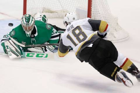 Vegas Golden Knights left wing James Neal (18) scores a goal against Dallas Stars goalie Kari L ...