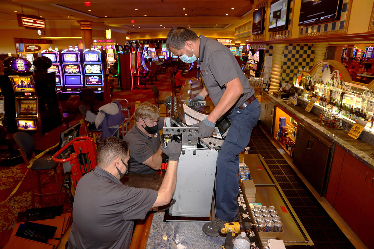 International Game Technology technicians, from left, Saul Rivera, Tommy Esposito and Randy Oll ...