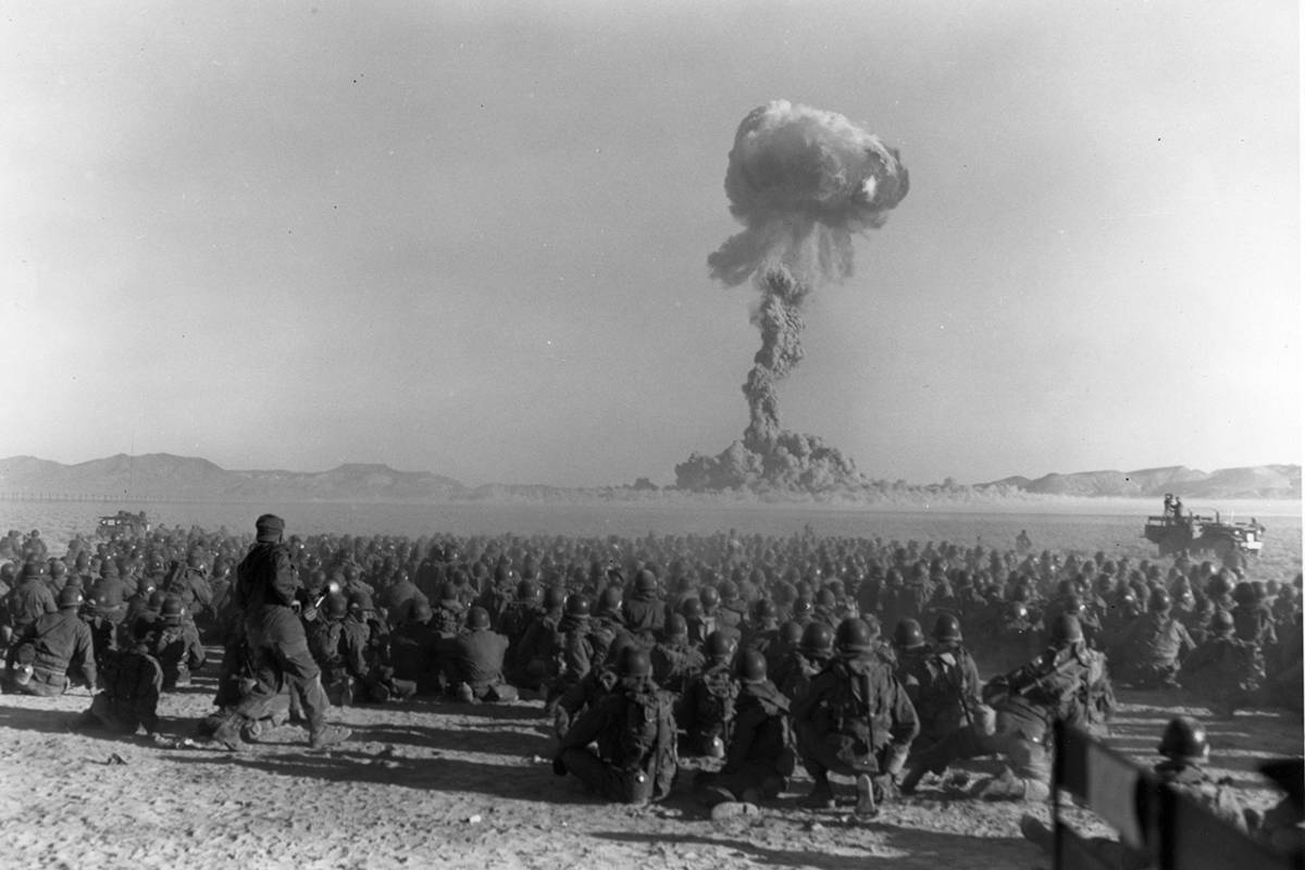 This early photo shows an atomic bomb test at what was then called the Nevada Proving Grounds, ...