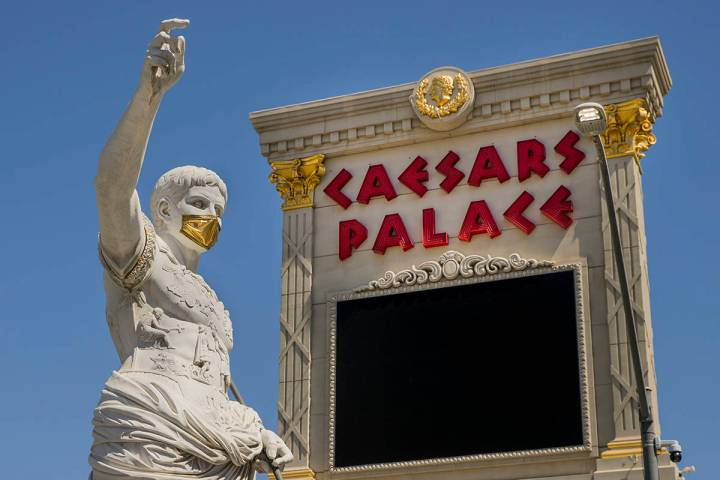 Caesars Entertainment Corp. on Thursday said an employee's failure to wear a mask on one of i ...