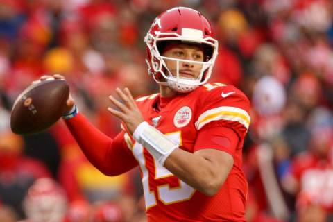 Kansas City Chiefs quarterback Patrick Mahomes (15) prepares to throw the football during the f ...