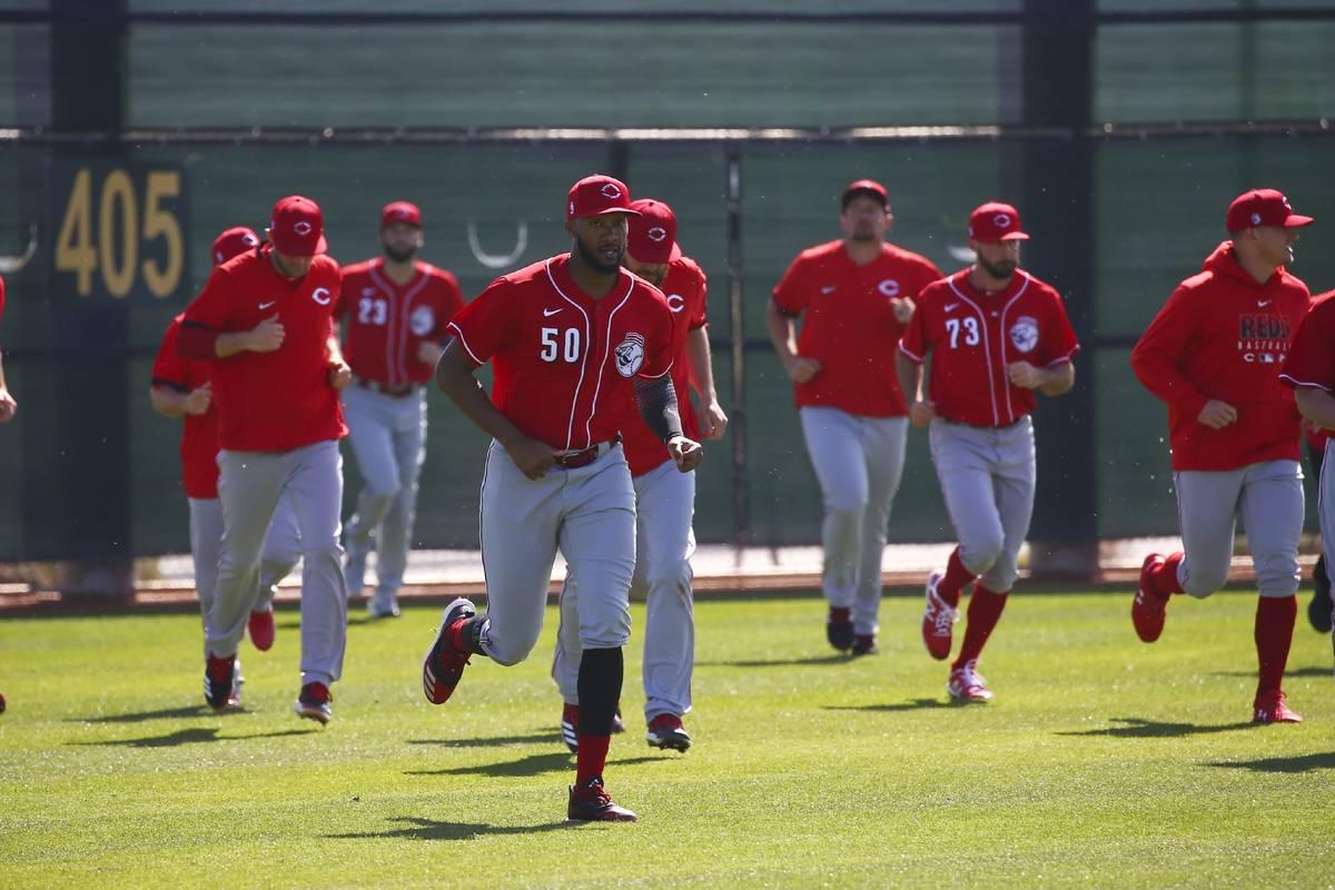 In this Feb. 17, 2020, file photo, Cincinnati Reds relief pitcher Amir Garrett leads other pitc ...
