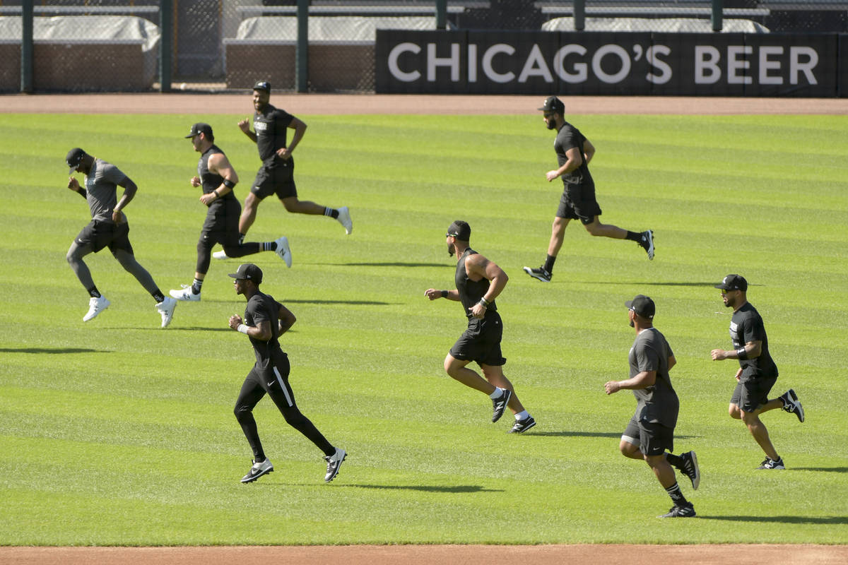 The Chicago White Sox warm up before practice at Guaranteed Rate Field, Sunday, July 5, 2020, i ...