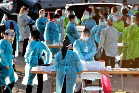 In a June 27, 2020, file photo, medical personnel prepare to test hundreds of people lined up i ...