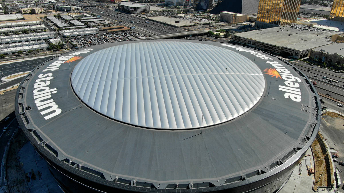 Aerial view of Allegiant Stadium roof top logos that will light up at night on Wednesday, July ...