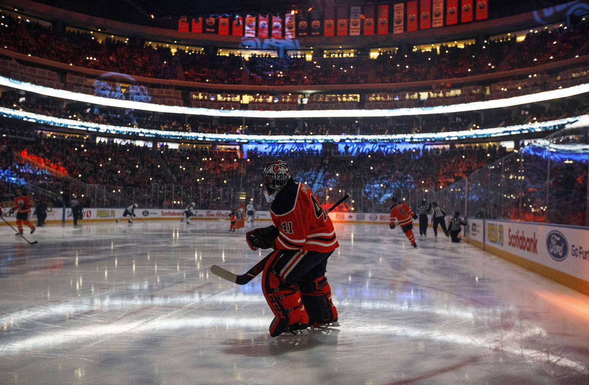 In this Feb. 20, 2020, file photo, Edmonton Oilers goalie Mike Smith warms up for the team's NH ...