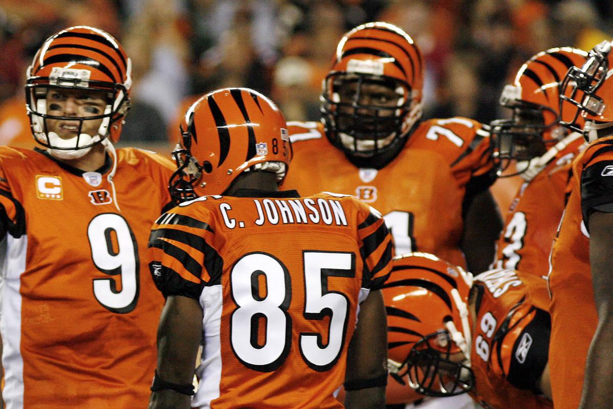 Cincinnati Bengals quarterback Carson Palmer, gesters as receiver Chad Johnson (81) looks on du ...