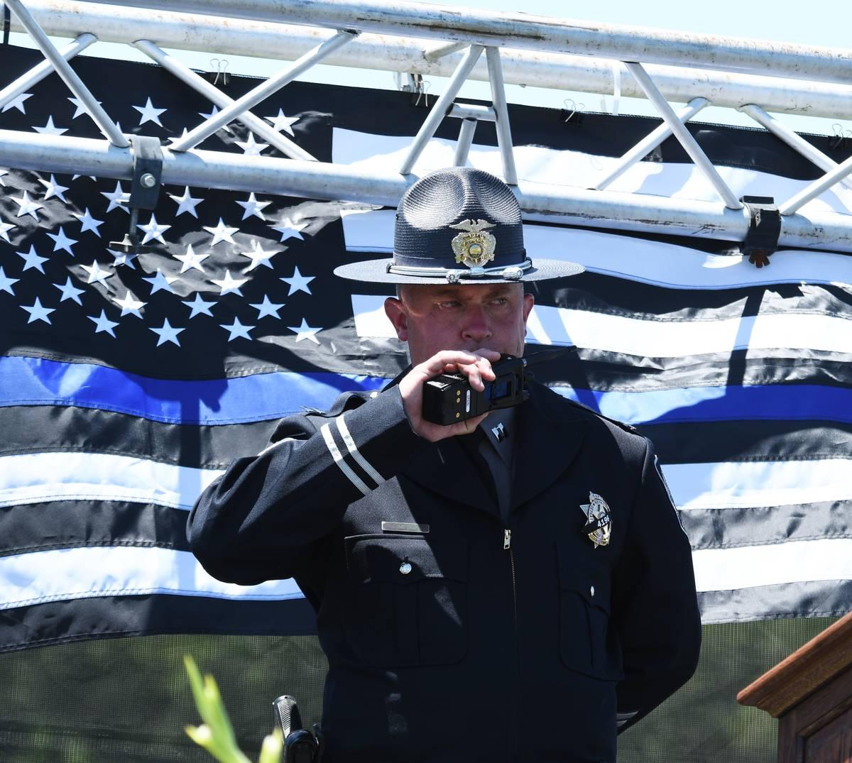Nevada Highway Patrol Capt. James Simpson calls out Sgt. Benjamin Jenkins' 'Final Watch, 10-42' ...