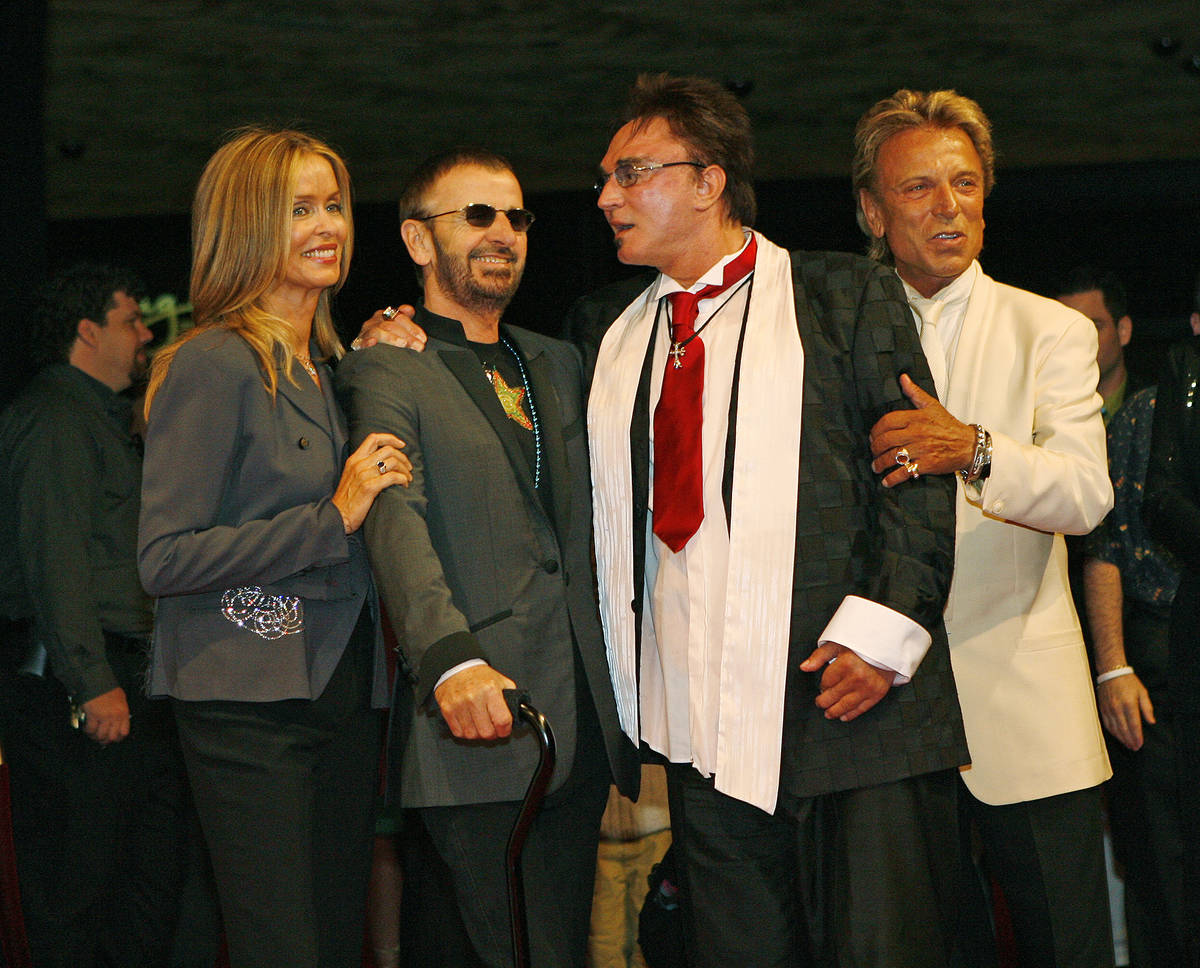 Ringo Starr and his wife Barbara Bach pose for photos with Siegfried and Roy during arrivals at ...