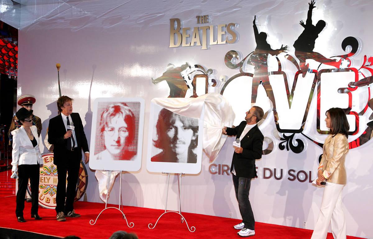 Yoko Ono, left, wife of the late John Lennon, along with Olivia Harrison, right, wife of the la ...