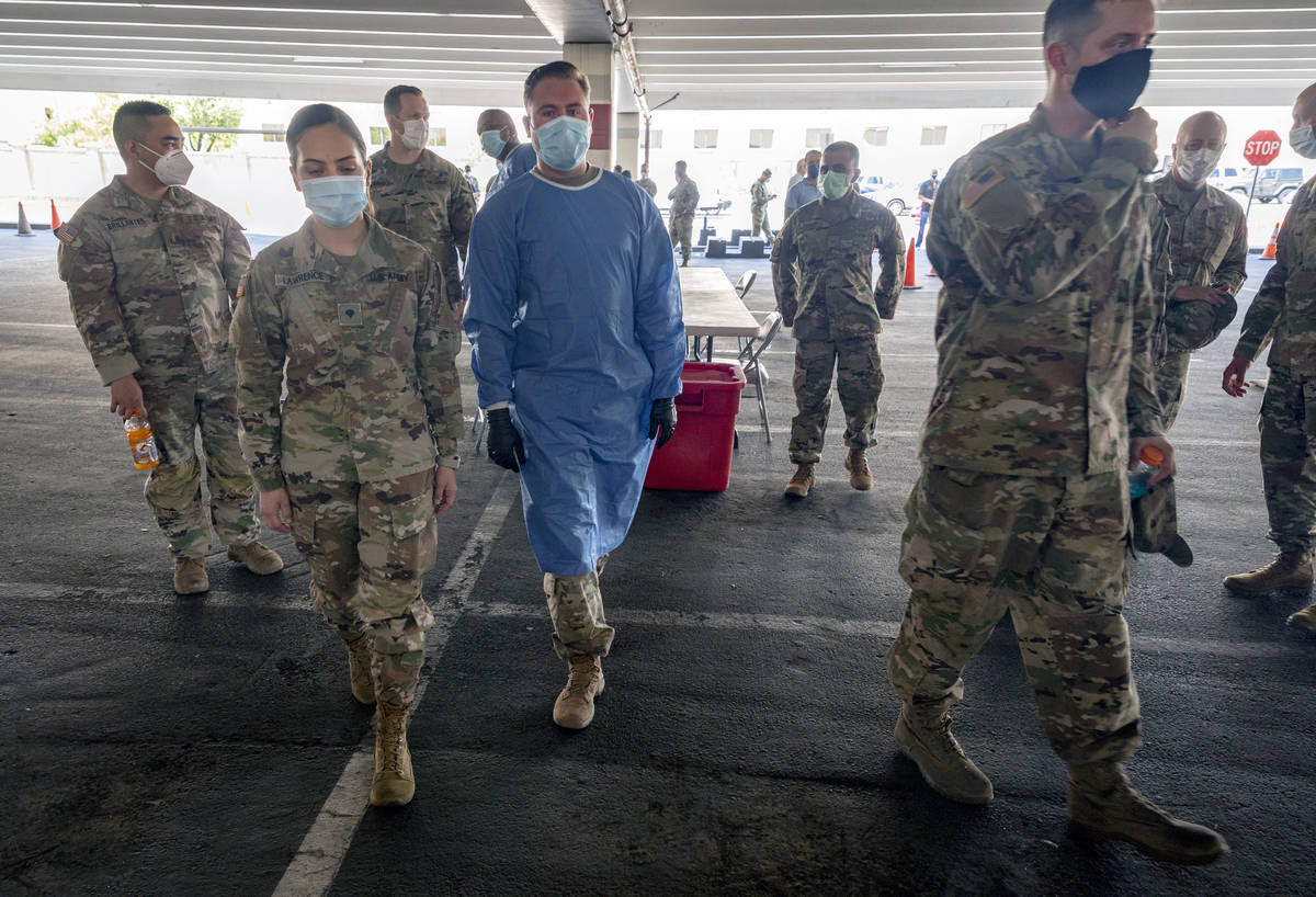 Nevada National Guardsmen take part in a preview of the new drive-thru COVID-19 testing site in ...