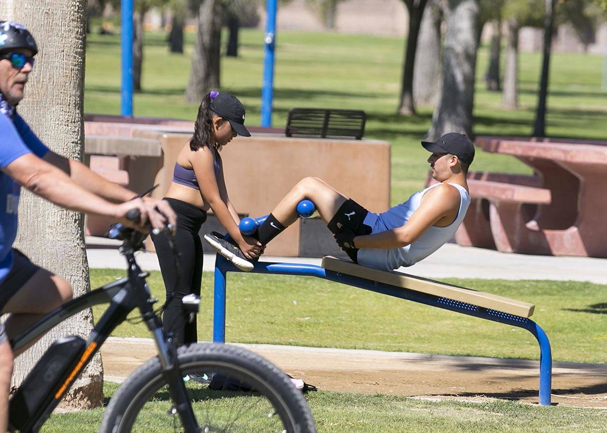 Cruz Lora, right, and his niece Bella exercise at Sunset Park on Wednesday, July 8, 2020, in La ...