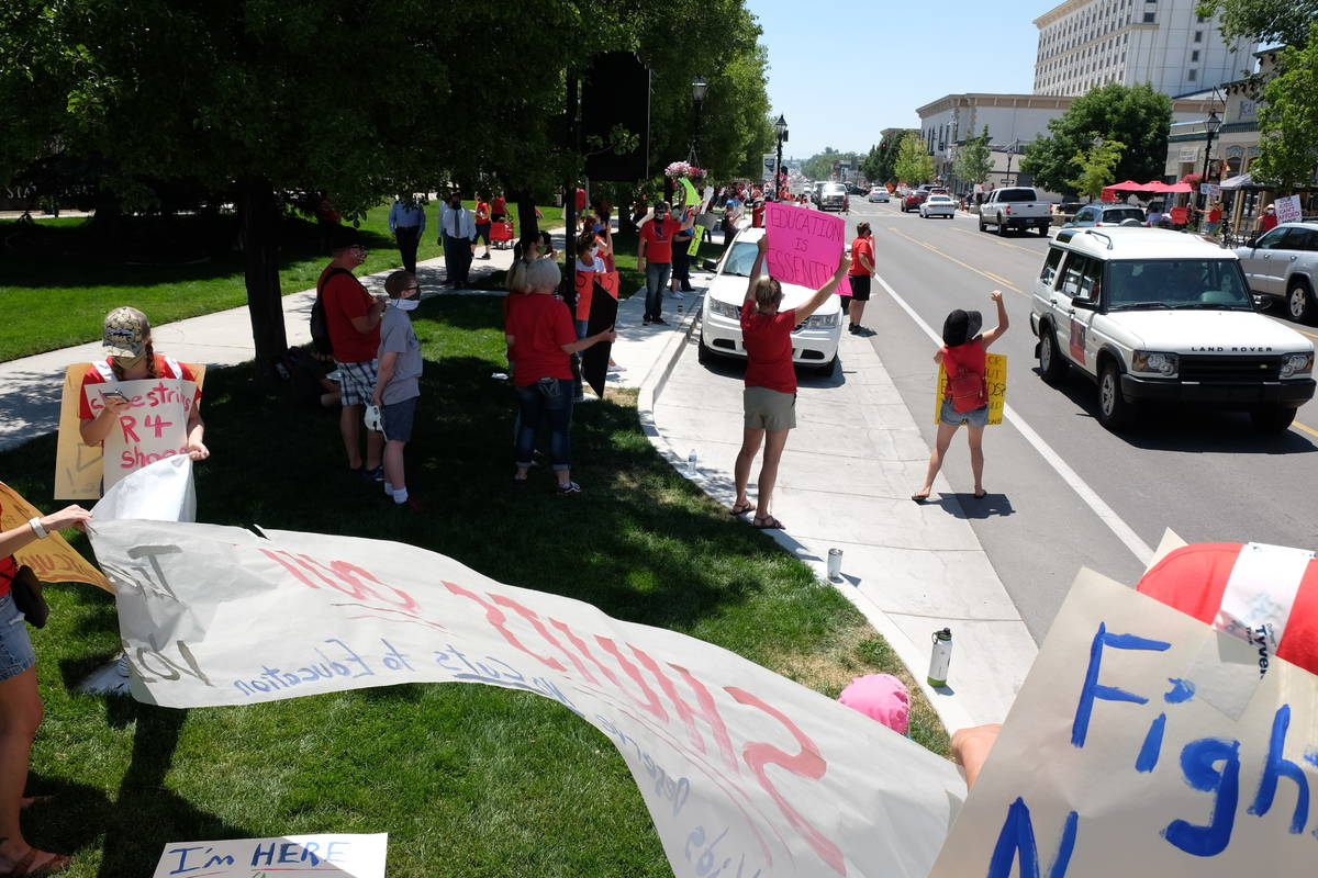 Education advocates protesting possible state budget cuts line Carson Street outside the Nevada ...