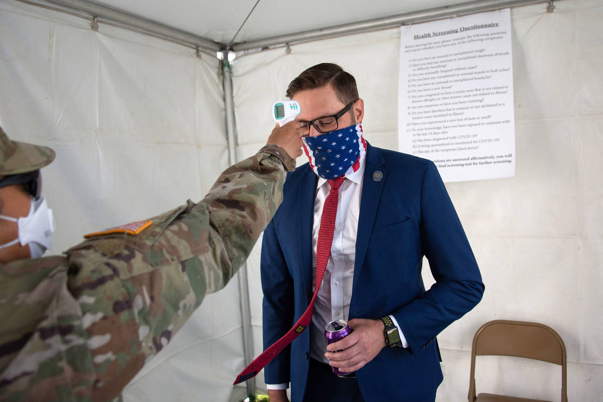 Nevada Assemblyman, Gregory Hafen II gets his temperature checked before the first day of the 3 ...