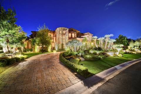This 14,070-square-foot mansion in The Ridges in Summerlin will go to auction Aug. 1. It includ ...