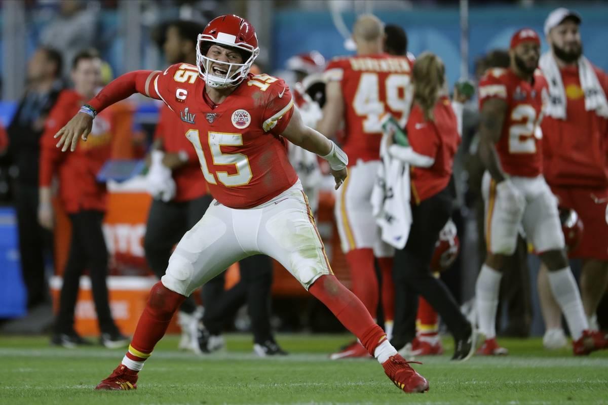 Kansas City Chiefs' quarterback Patrick Mahomes celebrates his touchdown pass to Damien William ...