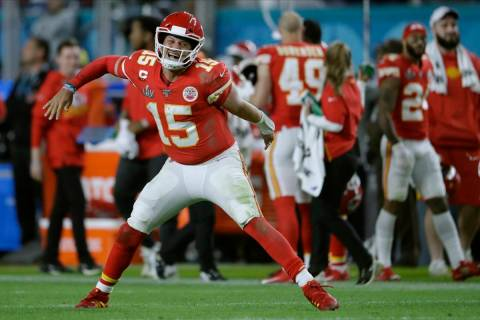 Kansas City Chiefs' quarterback Patrick Mahomes celebrates his touchdown pass to Damien William ...