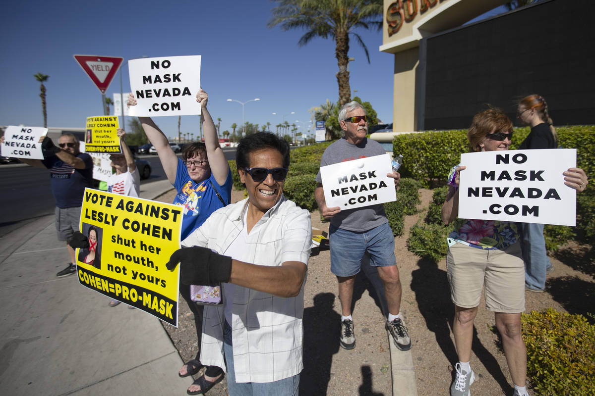 """Jose Luis, of Las Vegas, participates in the """"No Mask Protest"""" at the intersection of West Suns ..."""