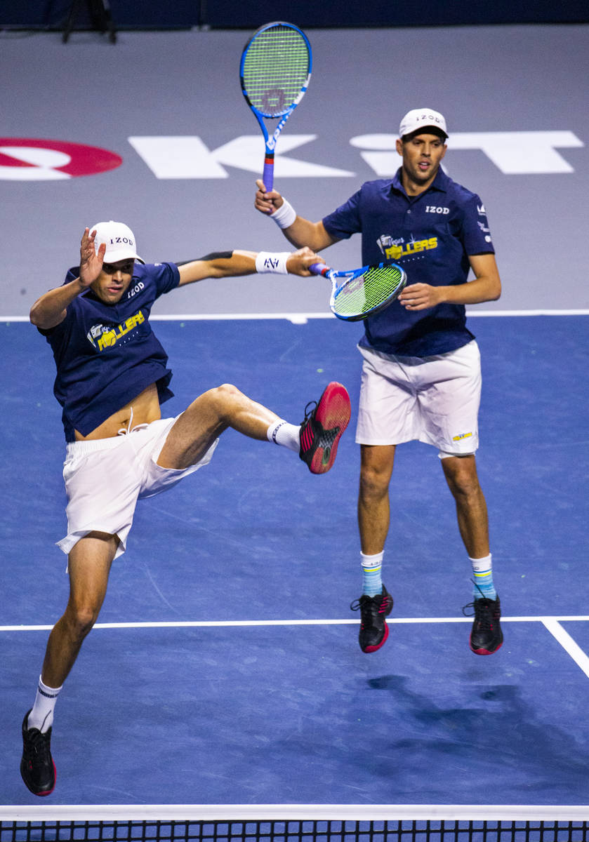 The Vegas Rollers' Bob and Mike Bryan come together after a shot during their men's doubles set ...