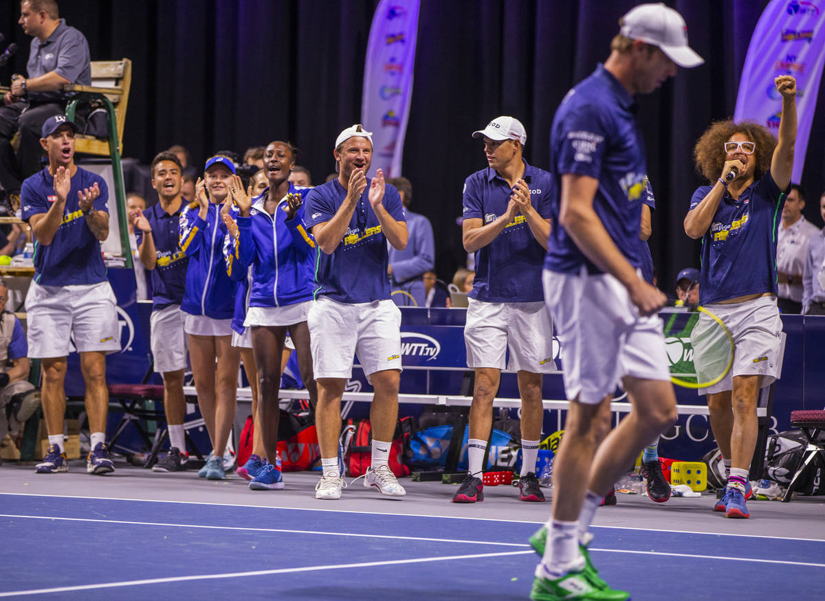 Vegas Rollers' teammates congratulate Sam Querrey as he closes the gap in score during his men' ...