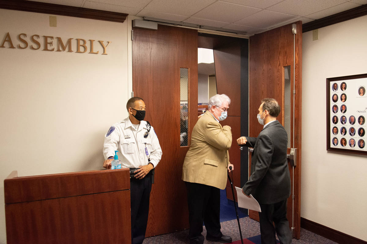 Nevada Assemblyman, John Hambrick greets a colleague outside of the Assembly chambers on the fi ...