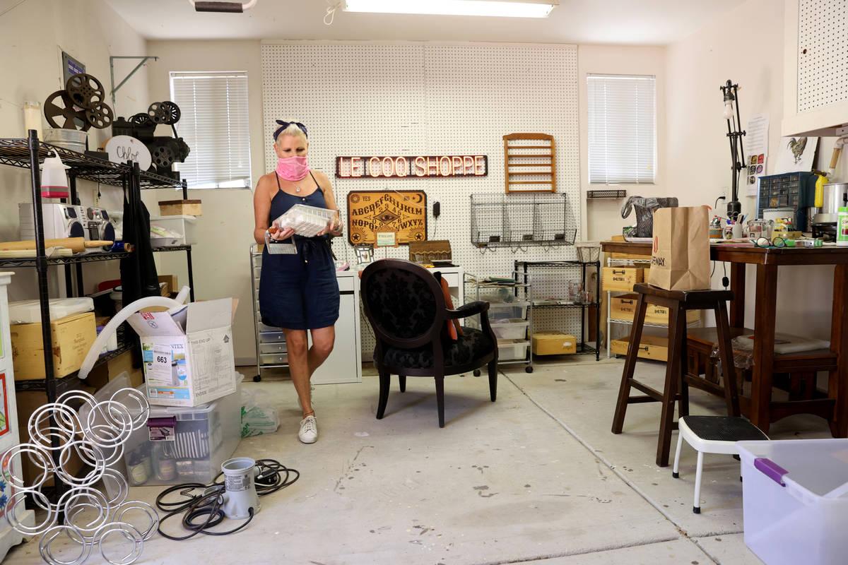 Susan Marsian-Bolduc packs her belongings in the workshop of her Las Vegas home Thursday, July ...