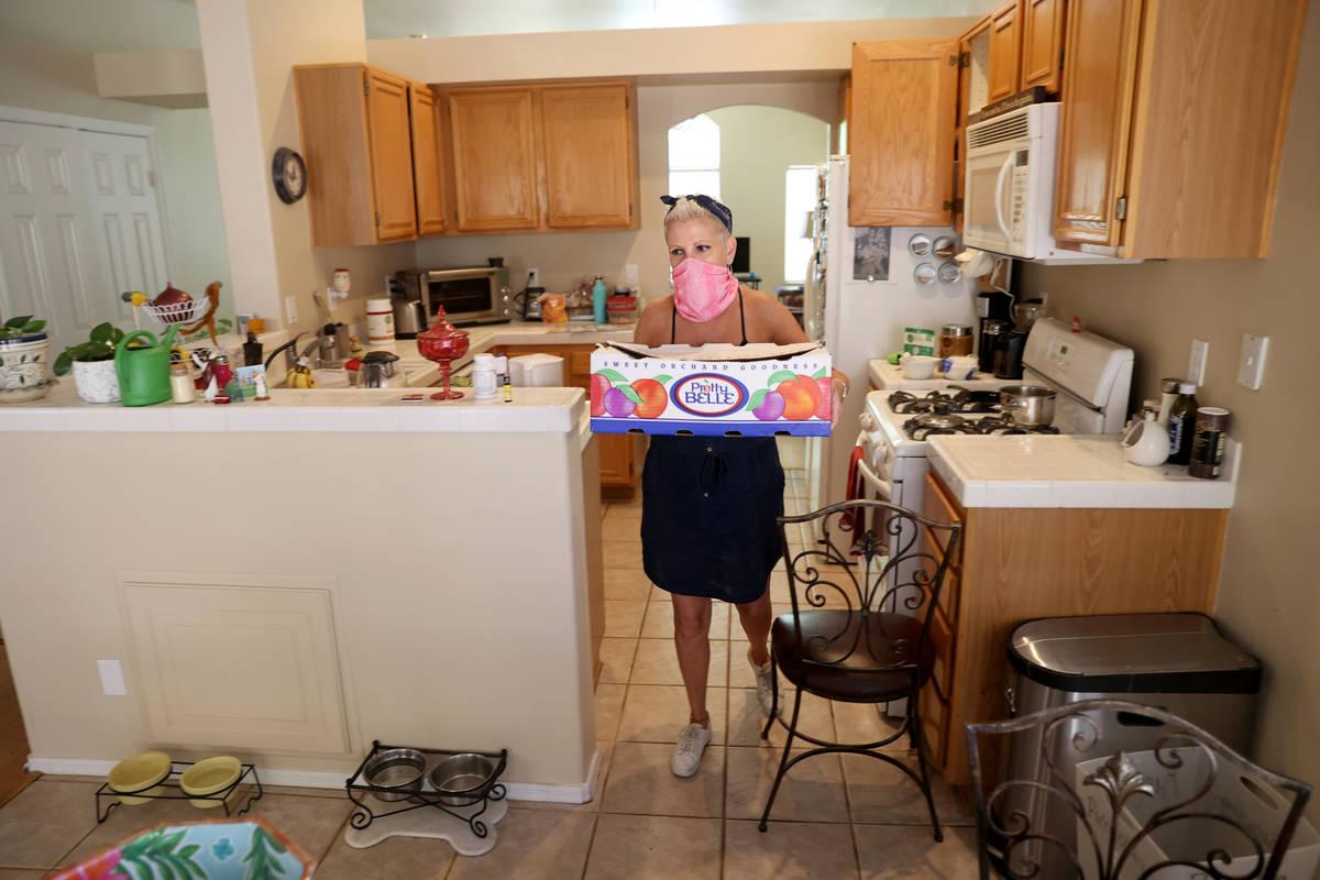Susan Marsian-Bolduc packs her belongings in her Las Vegas home Thursday, July 9, 2020. Marsian ...