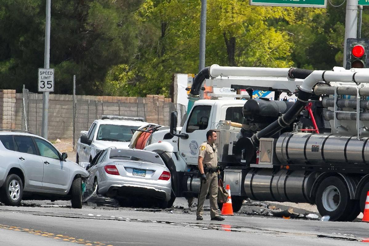 The Metropolitan Police Department investigates a three-car crash at Oakey Boulevard and Rancho ...