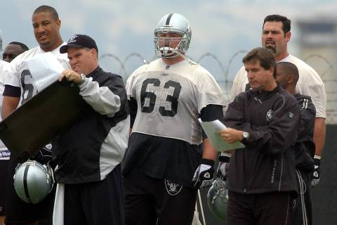 Oakland Raiders center Barret Robbins (63) stands beside coach Bill Callahan, right, during a w ...