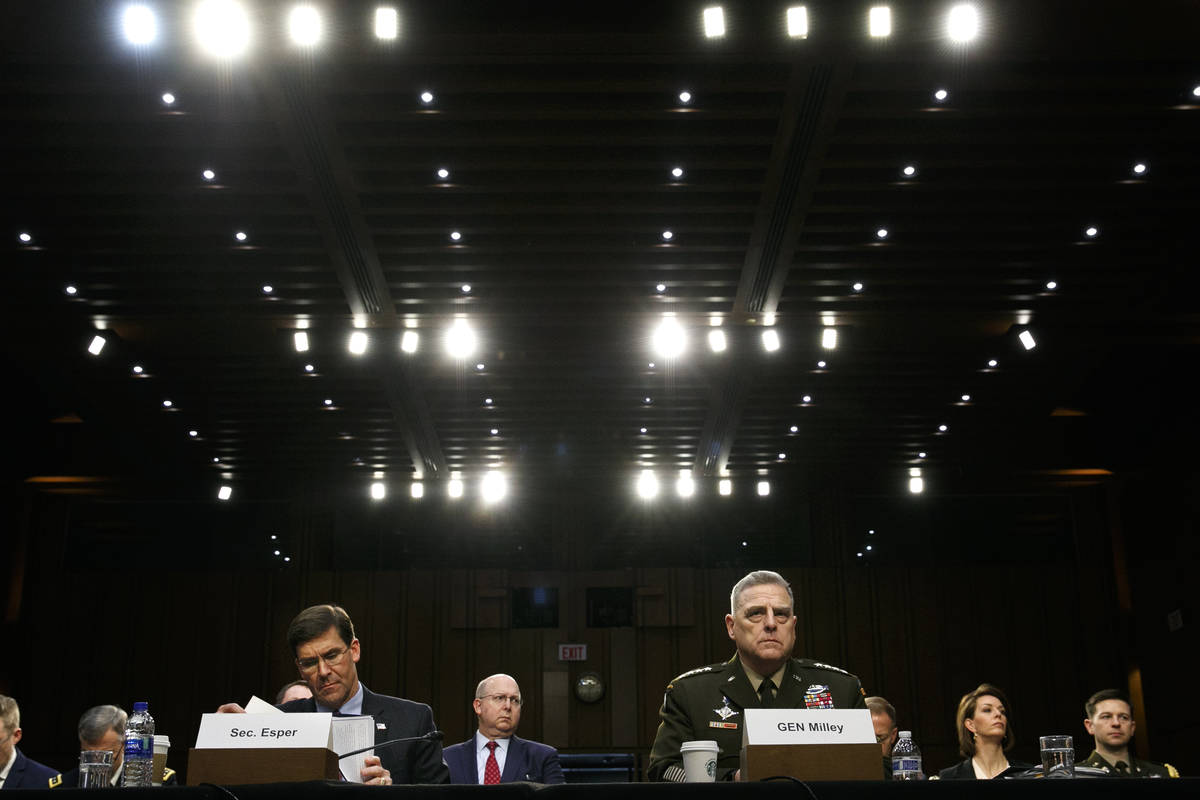 In a March 4, 2020, file photo Defense Secretary Mark Esper, left, and Chairman of the Joint Ch ...