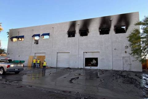 A crew begins to secure the Canyon Electric Company Inc. building after and early morning two-a ...