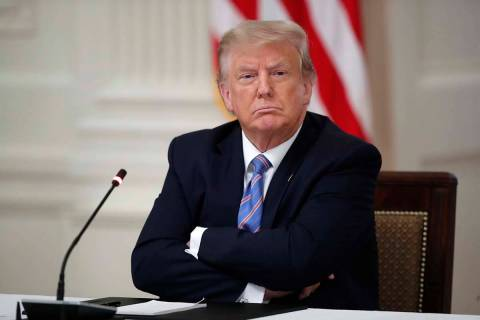 """President Donald Trump listens during a """"National Dialogue on Safely Reopening America's S ..."""