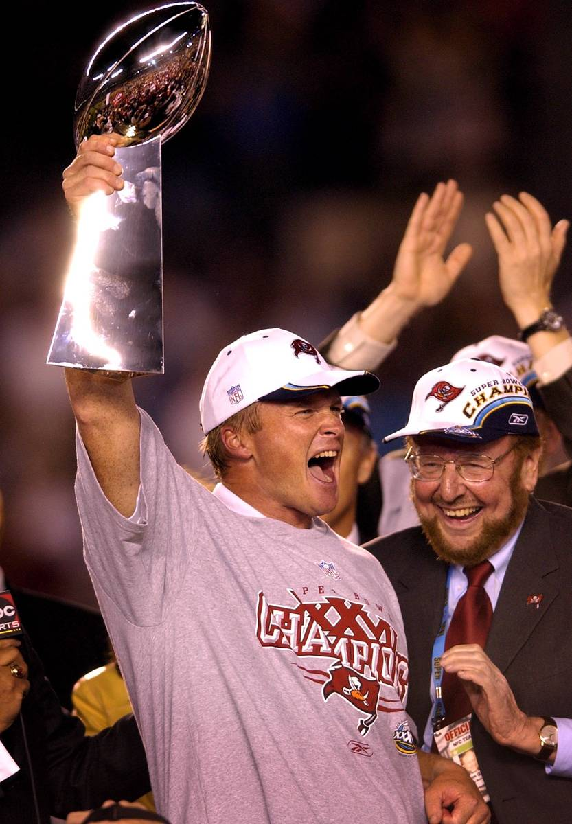 Tampa Bay Buccaneers head coach Jon Gruden, left, hoists the Vince Lombardi trophy as team owne ...