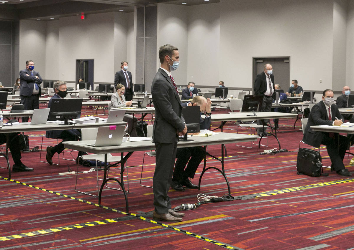 Attorneys, including Jordan Smith, center, representing Essence dispensary, are seen during a p ...