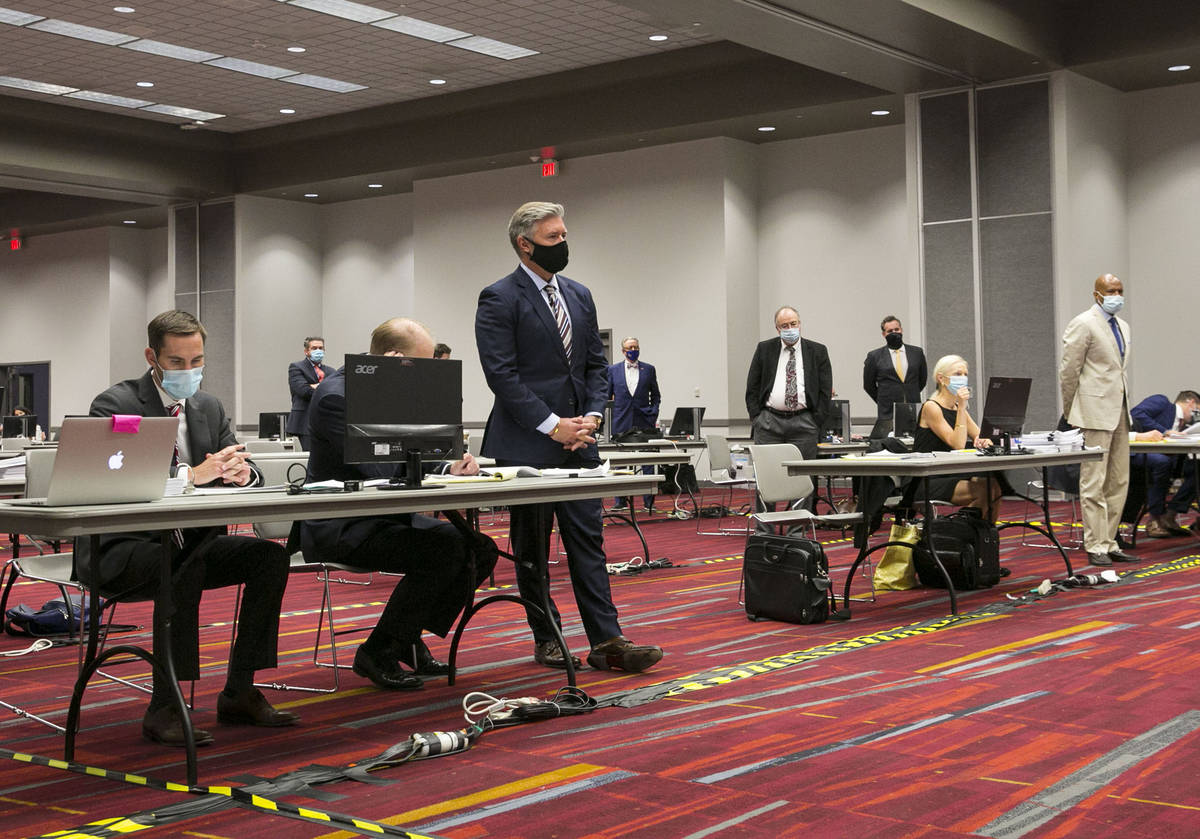 Attorneys, including Dennis Prince, left standing, representing Thrive dispensary, are seen dur ...