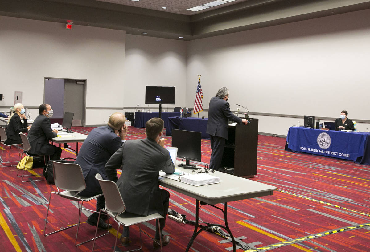 Judge Elizabeth Gonzalez, right, listens as Will Kemp, representing Planet 13 and LivFree dispe ...