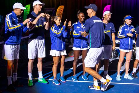 Vegas Rollers head coach Tim Blenkiron greets his team as they take the court for the second ho ...